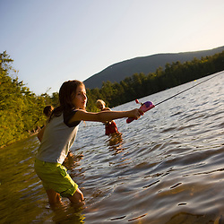 Kids fishing at White Lake State Park in Tamworth, New Hampshire.