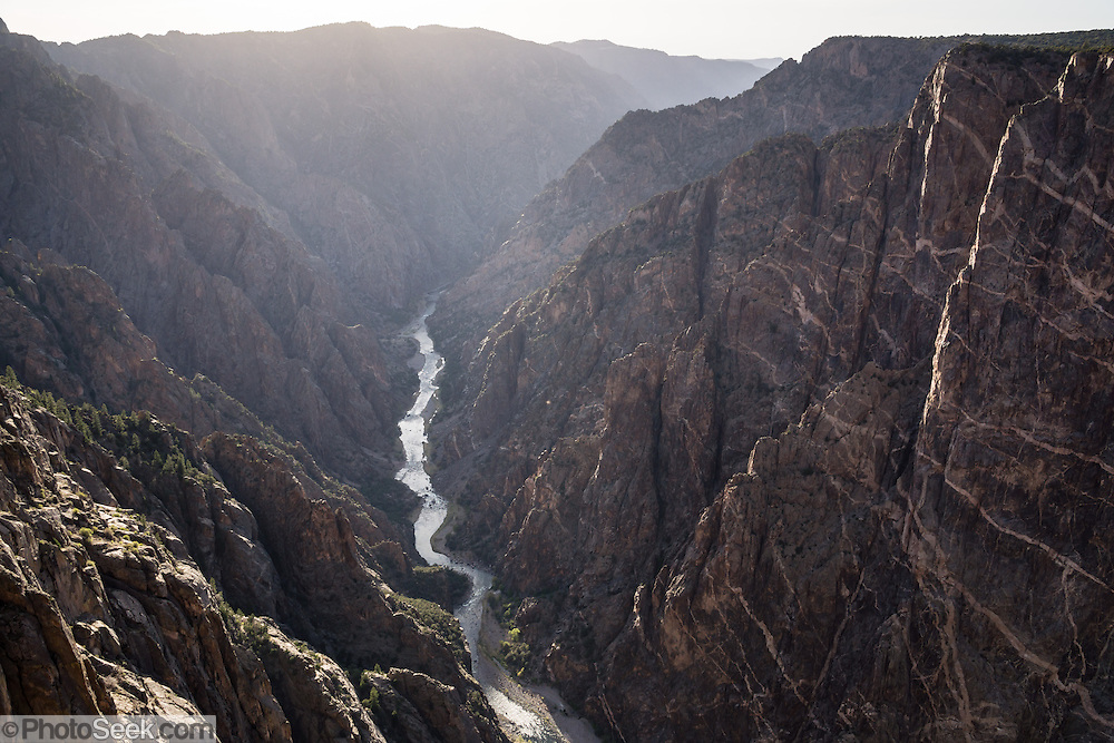 Dragon Point view, Black Canyon of the Gunnison National Park, near Montrose, Colorado, USA. The canyon exposes you to some of the steepest cliffs, oldest rock, and craggiest spires in North America. With two million years to work, the Gunnison River, along with the forces of weathering, has sculpted this vertical wilderness of rock, water, and sky.