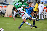 Team USA defender Armando Avila (3) is tripped up by  Team Guatemala midfielder Jarod Martinez (17) during a CONCACAF boys under-15 championship soccer game, Monday, Aug. 5, 2019, in Bradenton, Fla. The USA defeated Guatemala  2-0 (Kim Hukari/Image of Sport)