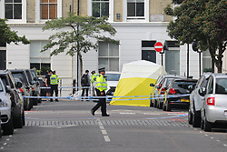 © Licensed to London News Pictures. 31/05/2018. London, UK. The scene at Cathcart Road, Kensington, where a man believed to be in his 40s was found with multiple stab wounds. The man died at the scene and a murder investigation has been launched. Photo credit: Rob Pinney/LNP
