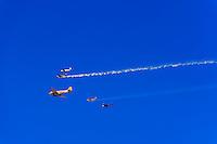 Vintage World War II aircraft fly above Santa Barbara, California USA on Veterans Day.