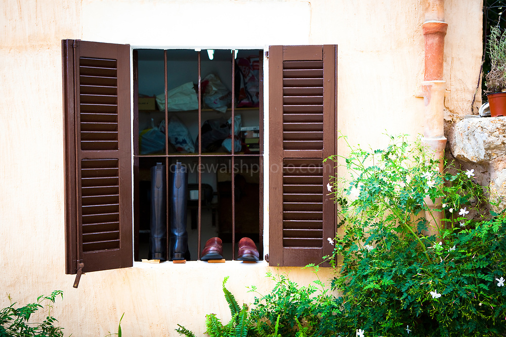 Shoe makers window in Pollenca, in north western Mallorca. The island is reknown for its leather factories and industry.