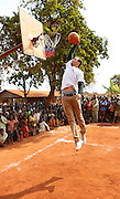 NBA superstar Stephen Curry has fun on a break at the Nyarugusu Refugee Camp in Tanzania, during a Nothing But Nets trip to distribute anti-malaria bed nets, Tuesday, July 30, 2013. (Insider Images/Stuart Ramson for UN Foundation)