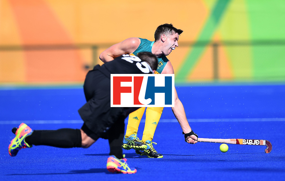 Australia's Andrew Charter controls the ball during the men's field hockey Australia vs New Zealand match of the Rio 2016 Olympics Games at the Olympic Hockey Centre in Rio de Janeiro on August, 6 2016. / AFP / MANAN VATSYAYANA        (Photo credit should read MANAN VATSYAYANA/AFP/Getty Images)