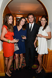 Left to right, ELLE CARING, LUCY PERFECT, BEN CARING and AMY PERFECT at an exhibition of the 50 best party pictures from Tatler from the past 50 years, held at Annabel's, Berkeley Square, London on 9th September 2013.