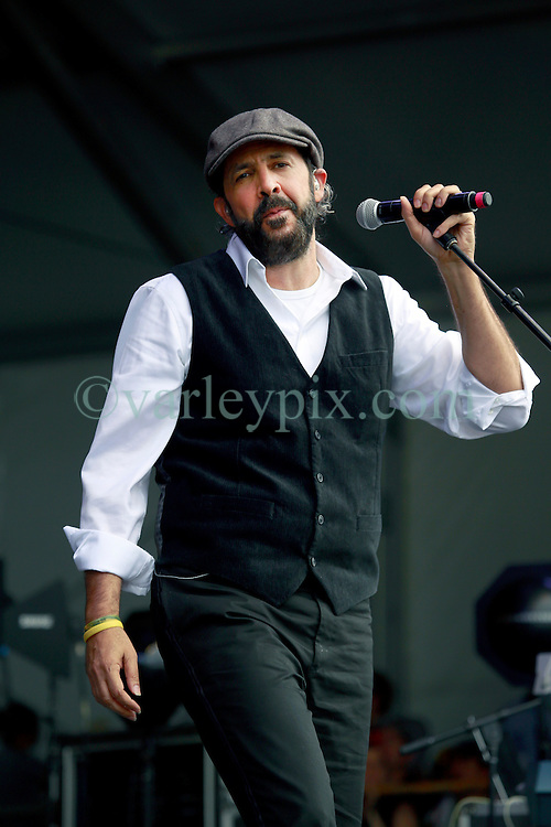 28 April 2013. New Orleans, Louisiana,  USA. .Juan Luis Guerra, legendary Latin musician plays the Congo Square stage at the New Orleans Jazz and Heritage Festival. Guerra is one of the most recognised Latin artists with 15 Latin Grammy Awards and 2 Grammy Awards to his name amongst a host of other accolades..Photo; Charlie Varley.