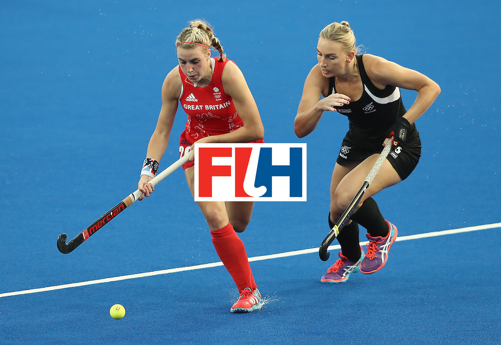 RIO DE JANEIRO, BRAZIL - AUGUST 17:  Lily Owsley of Great Britain breaks with the ball from Pippa Hayward (R) during the Women's hockey semi final match betwen New Zealand and Great Britain on Day12 of the Rio 2016 Olympic Games at the Olympic Hockey Centre on August 17, 2016 in Rio de Janeiro, Brazil.  (Photo by David Rogers/Getty Images)