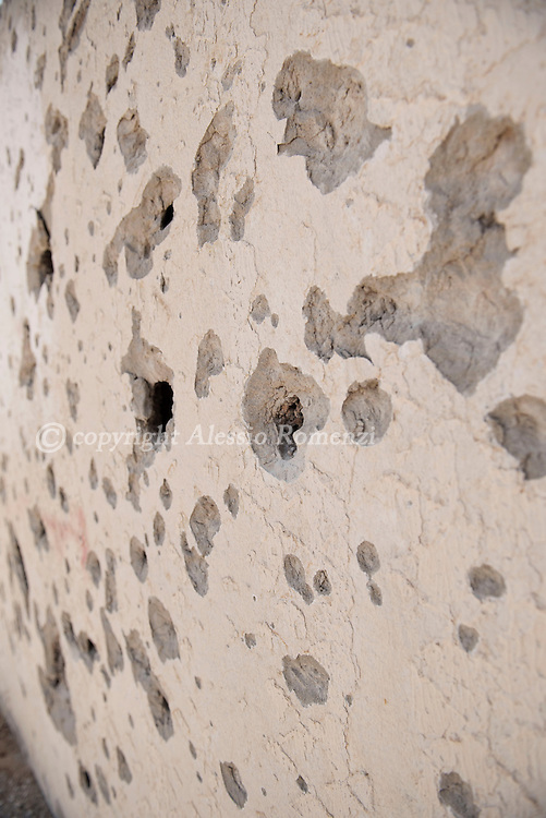 Libya: Particular of a riddled by gunshots and shrapnels wall in 700 neighbourhood in Sirte. Alessio Romenzi