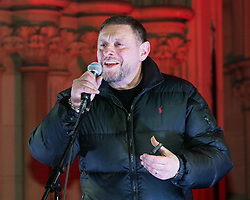 """© Licensed to London News Pictures . 03/02/2015 . Manchester , UK . Madchester star SHAUN RYDER , speaks to the crowd , at the demonstration . Demonstration organised by the Labour Party on the steps of Manchester City Council in Albert Sqaure , Manchester , under the banner """"manVcam"""" ( Manchester vs Cameron ) . Organisers say Manchester - along with Liverpool and Birmingham - have suffered larger cuts than other regional authorities , whilst southern regions such as Surrey , Hampshire and West Sussex have all seen increases in government funding . Photo credit : Joel Goodman/LNP"""