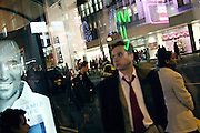 People waiting for the bus heading home after a long day of shopping, Oxford Street, central London, on Wednesday, Dec. 22, 2004.  **ITALY OUT**
