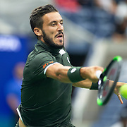 2019 US Open Tennis Tournament- Day Three. Damir Dzumhur of Bosnia and Herzegovina in action against Roger Federer of Switzerland in the Men's Singles Round Two match on Arthur Ashe Stadium at the 2019 US Open Tennis Tournament at the USTA Billie Jean King National Tennis Center on August 27th, 2019 in Flushing, Queens, New York City.  (Photo by Tim Clayton/Corbis via Getty Images)