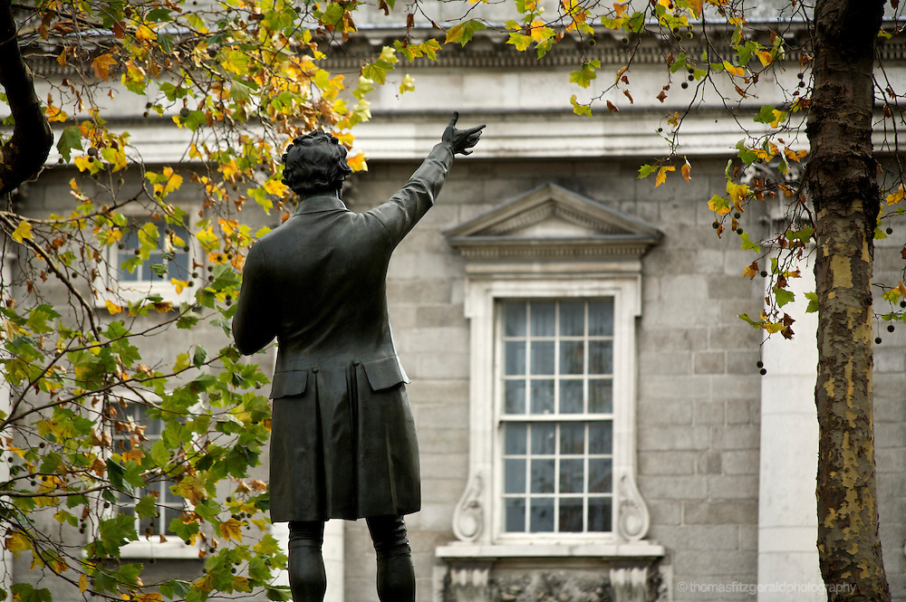 A statue infront of the fascade of trinity college