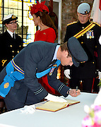 03.JUNE.2012. LONDON<br /> <br /> PRINCE WILLIAM SIGNING THE ROYAL GUEST BOOK AT HMS PRESIDENT. EARLIER, THE QUEEN AND PRINCE PHILIP WERE ONBOARD THE ROYAL BARGE, THE SPIRIT OF CHARTWELL WITH SEVERAL OTHER ROYAL FAMILY MEMBERS CELEBRATING THE QUEEN'S DIAMOND JUBILEE PAGEANT ON THE RIVER THAMES IN LONDON<br /> <br /> BYLINE: EDBIMAGEARCHIVE.CO.UK<br /> <br /> *THIS IMAGE IS STRICTLY FOR UK NEWSPAPERS AND MAGAZINES ONLY*<br /> *FOR WORLD WIDE SALES AND WEB USE PLEASE CONTACT EDBIMAGEARCHIVE - 0208 954 5968*