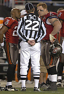 (TAMPA 01/07/2006) Ronde Barber (20) and Chris Hovan (95) talk with head linesman (22) Steve Stelljes after Edell Shepherd's fourth quarter touchdown was ruled an incomplete catch. STORY SUMMARY:  Washington Redskins at Tampa Bay Buccaneers Saturday (1/7/2006) at Raymond James Stadium in Tampa. (Times photo by: Brendan Fitterer)