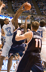 UNC's Brandan Wright (34) blocks a shot by Virginia's Will Harris (1).  The #1 ranked Tar Heels beat the Cavaliers 79-69 to improved to 15-1 overall, 2-0 ACC on January 10, 2007 at the Dean Smith Center in Chapel Hill, NC.<br />