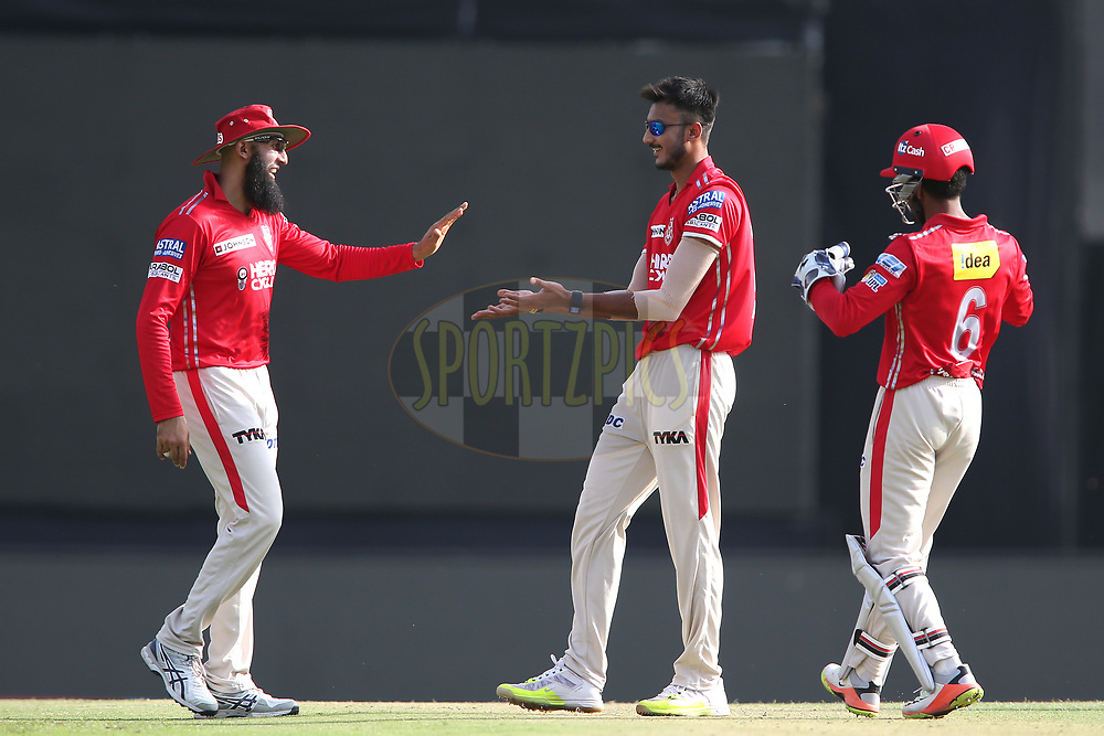 Hashim Amla of Kings XI Punjab congratulates Akshar Patel of Kings XI Punjab for getting Chris Morris of the Delhi Daredevils wicket during match 36 of the Vivo 2017 Indian Premier League between the Kings XI Punjab and the Delhi Daredevils held at the Punjab Cricket Association IS Bindra Stadium in Mohali, India on the 30th April 2017<br /> <br /> Photo by Shaun Roy - Sportzpics - IPL