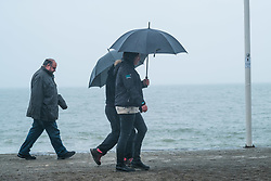 © Licensed to London News Pictures. 16/03/2017. Aberystwyth, Wales, UK. After the glorious sunshine of the day before, the weather has turned wet and grey in Aberystwyth, with people sheltering under their umbrellas as they walk along the now deserted promenade in the morning. More unsettled conditions with some high winds are forecast in the coming days, as the tail end of Storm Stella works its way across the Atlantic. Photo credit: Keith Morris/LNP