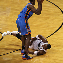 Jun 21, 2012; Miami, FL, USA; Oklahoma City Thunder power forward Serge Ibaka (9) recovers a loose ball as Miami Heat power forward Chris Bosh (1) is on the ground during the first quarter in game five in the 2012 NBA Finals at the American Airlines Arena. Mandatory Credit: Derick E. Hingle-US PRESSWIRE