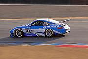 Image of a Porsche 911 sports car racing at Rennsport Reunion IV, Laguna Seca, California, America west coast