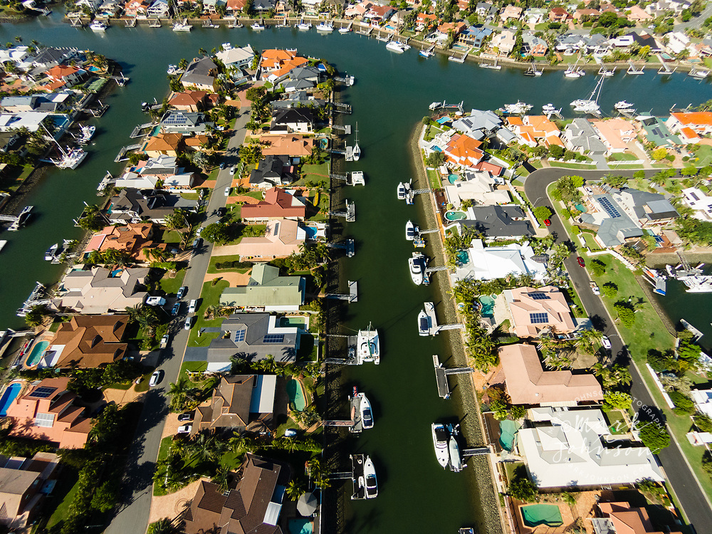 Aerial photograph of homes and boats in a canal subdivision, Birkdale, Queensland, Australia