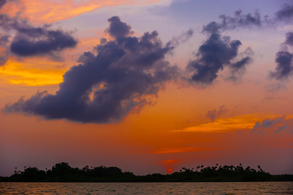 Sunset seen from the Sian Ka'an Biosphere Reserve, in Riviera Maya, Mexico, which is a small ecotourism and education center, it serves as a model for sustainable development in sensitive tropical ecosystems. It is a UNICEF World Heritage Site and is the third largest natural protected area in Mexico.