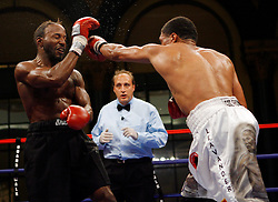 August 31, 2007; Atlantic City, NJ, USA; Shamone Alvarez (white trunks) and Germaine Sanders (black trunks) trade punches during their 12 round NABO Welterweight championship bout at Boardwalk Hall in Atlantic City, NJ.  Alvarez retained his title via unanimous decision.
