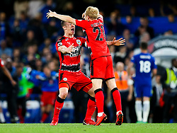 Jonathan Hogg and Alex Pritchard celebrate after the game ends 1-1 giving Huddersfield Town the point needed to keep them in the Premier League and relegate Swansea City - Rogan/JMP - 09/05/2018 - FOOTBALL - Stamford Bridge - London, England - Chelsea v Huddersfield Town - Premier League.