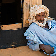 A patient waiting outside the pharmacy tent for his turn to be called at a Médecins Sans Frontières (MSF) health centre at the Mbera camp for Malian refugees in Mauritania on 3 March 2013.