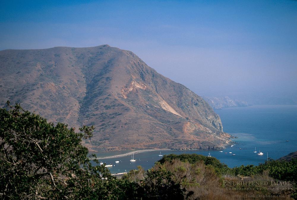 Overlooking steep rugged coastal hills above boats anchored in Catalina Harbor, Catalina Island, California