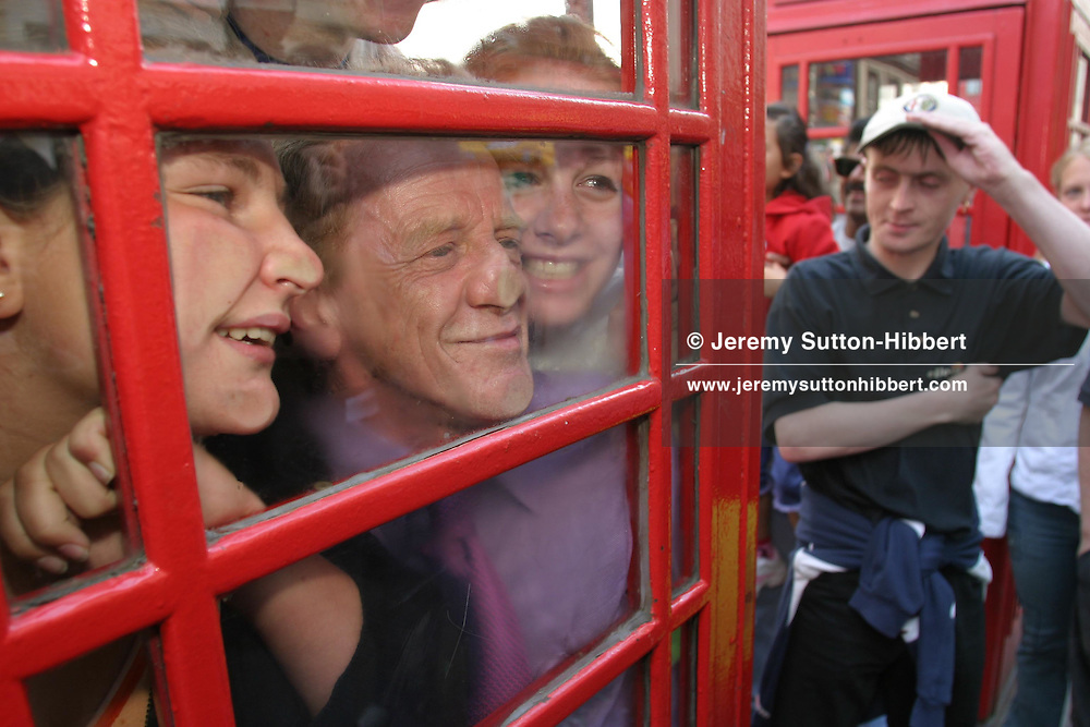 "The un-official attempt to break the record for most people in a telephone box. 14 people were put inside and the door shut. The attempt is unoffical as the Guinness Book of Records does not recognize it due to there being no standard size of phone box. The attempt was made by 'Kabosh"" theatre group to advertise their show at the festival called Rhinoceros-Theatre in a Box...Edinburgh Festival 2003.Edinburgh, Scotland."