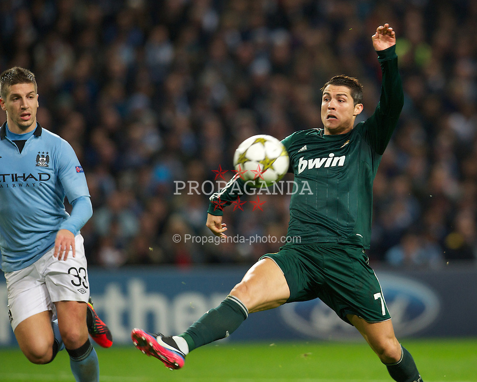 MANCHESTER, ENGLAND - Wednesday, November 21, 2012: Real Madird CF's Cristiano Ronaldo in action against Manchester City during the UEFA Champions League Group D match at the City of Manchester Stadium. (Pic by David Rawcliffe/Propaganda)
