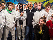 27 NOVEMBER 2019 - DES MOINES, IOWA: US Senator CORY BOOKER (D-NJ) poses for photos with the Centennial High School basketball team after lunch at Central Iowa Shelter and Services in Des Moines. They had to bump elbows rather than shake hands because Sen Booker was wearing gloves to handle food. Sen Booker helped plate up and serve lunch at the shelter. The shelter has about 180 beds and is full almost every night. In January and February, more than 250 people per night come to the shelter, which sets out overflow bedding. Senator Booker is running to be the Democratic nominee for the US Presidency in 2020. Iowa hosts the first selection event of the presidential election season. The Iowa caucuses are February 3, 2020.        PHOTO BY JACK KURTZ