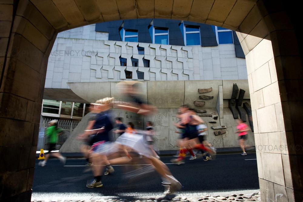 Runners run past the Scottish Parliament  as 10,000 Runners take part in the 10km Bupa Great Edinburgh Run 3/5/09.Picture Michael Hughes/Maverick