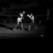 "4/27/12 7:36:20 PM --- LA HABRA BOXING CLUB SPORTS SHOOTER ACADEMY 009 -- La Habra, California. Alex ""The Future"" Gonzalez (right), 13, trains with Nadja Ropac Friday afternoon at La Habra Boxing Cllub. Photo by Swikar Patel, Sports Shooter Academy"