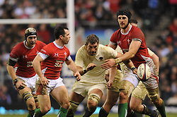 Simon Shaw (England) forces his way through to chase down a loose ball as Luke Charteris (Wales) attempts to stop him during the RBS 6 Nations Championship match between England and Wales at Twickenham Stadium on February 6, 2010 in London, England.