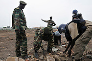 MAG deminers and SPLA officers work to clear a huge number of unexploded ordinance found scattered across a large, open terrain just opposite John Garang's tomb in Juba as the area was being prepared for South Sudan independence ceremonies. The Government of South Sudan called on Mines Advisory Group (MAG) to assist SPLA deminers in an attempt to clear the area and make it safe for the thousands of people and dignitaries who will be attending the declaration of independence on July 9th...Juba, South Sudan. 04/07/2011..Photo © J.B. Russell