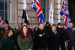 "London, February 8th 2015. Muslims demonstrate outside Downing Street  ""to denounce the uncivilised expressionists reprinting of the cartoon image of the Holy Prophet Muhammad"". PICTURED: Members of right wing anti-Islamic group Britain First, led by Paul Golding, centre, counter-demonstrate, chanting ""Muhammad is a paedophile!"""