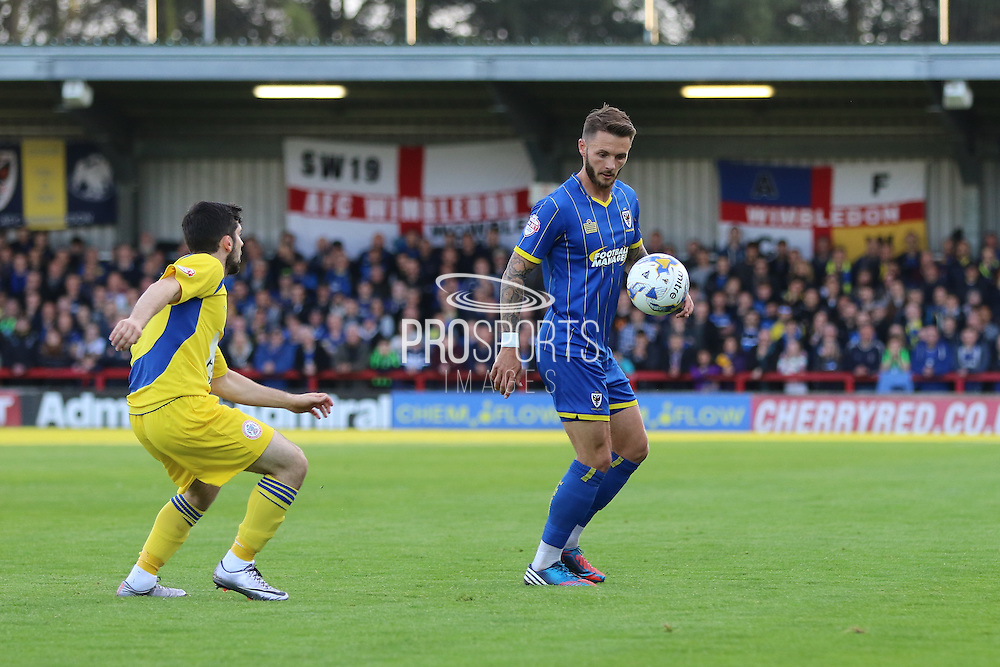 Callum Kennedy defender for AFC Wimbledon (3) holds the ball up from Piero Mingoia midfielder Accrington Stanley (7) during  the Sky Bet League 2 Play-Off first leg match between AFC Wimbledon and Accrington Stanley at the Cherry Red Records Stadium, Kingston, England on 14 May 2016. Photo by Stuart Butcher.