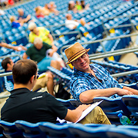 CLEARWATER, FL -- May 14, 2015 -- Former MLB and NFL player Drew Henson talks with a fellow scout as he scouts for the New York Yankees during a game between the Clearwater Threshers and the Charlotte Stone Crabs at Bright House Field in Clearwater, Florida. (PHOTO / CHIP LITHERLAND)
