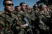 French soldiers of the 16th BC listen a last briefing before leaving Nejrab base on September 21, 2012. The 16th BC unit from Bitche (Moselle) had left that morning to join the Nejrab base with all hardware in contenairs. They will depart after the briefing for the Warehouse French base in Kabul, where they will spend a week disassembling their weapons, cleanning their tanks and preparing their departure for France. AFP PHOTO / JEFF PACHOUD