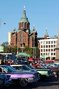 During summer from June to Septemper, every first Friday of the month is Vintage Car Cruising Night. Hundreds of classic American cars cruise around downtown Helsinki and meet at special places to have a good time, here at Kauppatori (Market Square), Uspenski orthodox cathedral in background.