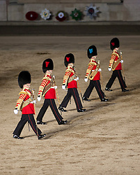© Licensed to London News Pictures. LONDON, UK  08/06/11. Band Leaders of the Guards Division march in formation across Horse Guards Parade. This year the opening night of Beating the Retreat took place with the American Ambassador receiving the salute. The traditional parade, involving all of the bands of the Household Division of the British Army, dates back to times when, after a day's battle, troops would retreat for the night.  Please see special instructions for usage rates. Photo credit should read Matt Cetti-Roberts/LNP