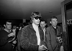 The Rolling Stones Charlie is my Darling - Ireland 1965 -..Mick Jagger of The Rolling Stones having passed through customs in Dublin Airport before the band's performance at the Adelphi Theatre, Middle Abbey Street, Dublin. This was the band's second Irish tour of 1965.....03/09/1965..09/03/1965..03 September 1965...The Rolling Stones Charlie is my Darling - Ireland 1965.Out November 2nd from ABKCO.Super Deluxe Box Set/Blu-ray and DVD Details Revealed. .ABKCO Films is proud to join in the celebration of the Rolling Stones 50th Anniversary by announcing exclusive details of the release of the legendary, but never before officially released film, The Rolling Stones Charlie is my Darling - Ireland 1965.  The film marked the cinematic debut of the band, and will be released in Super Deluxe Box Set, Blu-ray and DVD configurations on November 2nd (5th in UK & 6th in North America).. .The Rolling Stones Charlie is my Darling - Ireland 1965 was shot on a quick weekend tour of Ireland just weeks after ?(I Can't Get No) Satisfaction? hit # 1 on the charts and became the international anthem for an entire generation.  Charlie is my Darling is an intimate, behind-the-scenes diary of life on the road with the young Rolling Stones featuring the first professionally filmed concert performances of the band's long and storied touring career, documenting the early frenzy of their fans and the riots their live performances incited.. .Charlie is my Darling showcases dramatic concert footage - including electrifying performances of ?The Last Time,? ?Time Is On My Side? and the first ever concert performance of the Stones counterculture classic, ?(I Can't Get No) Satisfaction.?  Candid, off-the-cuff interviews are juxtaposed with revealing, comical scenes of the band goofing around with each other. It's also an insider's glimpse into the band's developing musical style by blending blues, R&B and rock-n-roll riffs, and the film captures the spark about to combust into The Greatest Rock an