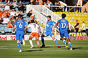 Peterborough United defender Jason Naismith (2) and Blackpool forward Nathan Delfouneso (7)  during the EFL Sky Bet League 1 match between Peterborough United and Blackpool at The Abax Stadium, Peterborough, England on 29 September 2018.