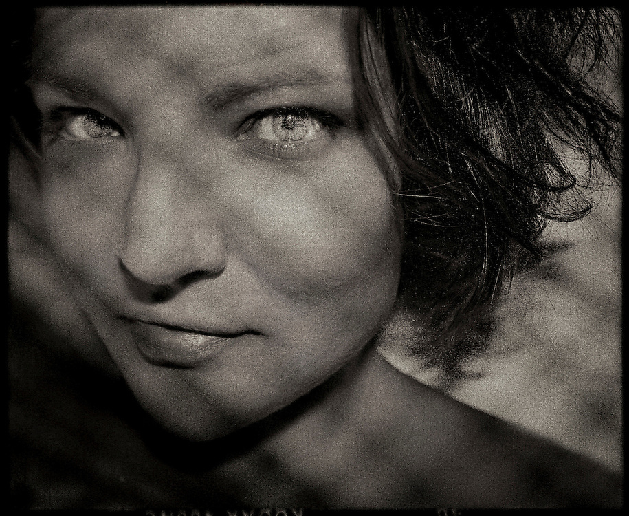 Close up of a young woman's face with shadows