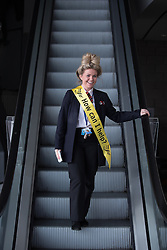 "© Licensed to London News Pictures . 04/10/2014 . Glasgow , UK . A woman wearing a yellow Liberal Democrat sash with "" How can I help? "" written across it . The Liberal Democrat Party Conference 2014 at the Scottish Exhibition and Conference Centre in Glasgow . Photo credit : Joel Goodman/LNP"