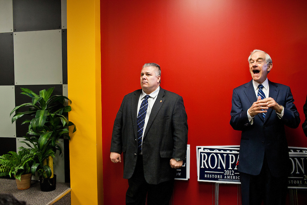 Republican presidential candidate Ron Paul, right, laughs as he is introduced at a campaign town hall meeting on Wednesday, December 28, 2011 in Newton, IA.