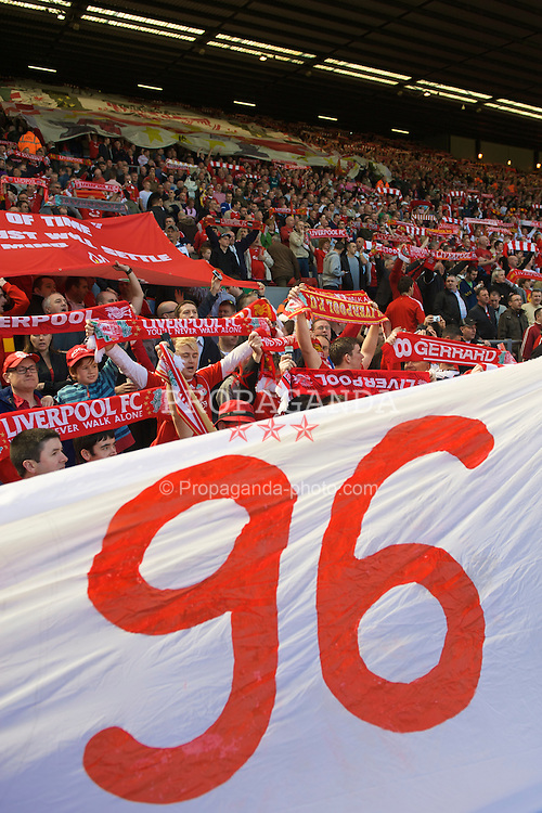 """LIVERPOOL, ENGLAND - Saturday, April 11, 2009: Liverpool's supporters sing """"You'll Never Walk Alone"""" in front of a banner remembering the 96 victims of the Hillsborough Stadium Disaster before the Premiership match at Anfield. (Photo by: David Rawcliffe/Propaganda)"""