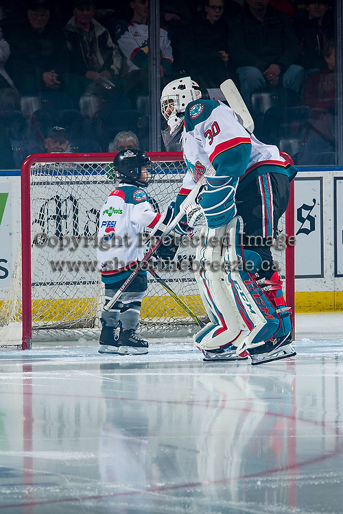 KELOWNA, CANADA - MARCH 13: The Pepsi Player of the game fist bumps Roman Basran #30 of the Kelowna Rockets against the Spokane Chiefs  on March 13, 2019 at Prospera Place in Kelowna, British Columbia, Canada.  (Photo by Marissa Baecker/Shoot the Breeze)