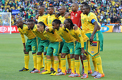 JOHANNESBURG, SOUTH AFRICA - Friday, June 11, 2010: South Africa's players line-up for a team-group photo before the opening match of the 2010 FIFA World Cup South Africa against Mexico at the Soccer City Stadium. Back row L-R: Siboniso Gaxa. Kagisho Dikgacoi, Katlego Mphela, goalkeeper Itumeleng Khune, Bongani Khumalo, Aaron Mokoena. Front row L-R: Lucas Thwala, Teko Modise, Steven Pienaar, Siphiwe Tshabalala, Reneilwe Letsholonyane. (Pic by Hoch Zwei/Propaganda)